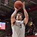 Ryan Daly shoots a basketball