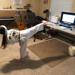Martial arts girl doing a sick kick while remote learning at home