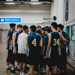 men's basketball players huddled together before a game