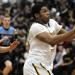 Hinsdale South's Orlando Brown finishes off a fast break