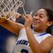 Maine East senior Elanta Slowek cuts down the net
