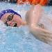 Evanston's Joseph Seguine-Hall swims the anchor leg of the 400-yard freestyle relay