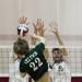 Providence's Ryan Siegers tries to spike the ball past Glenbrook North's Zach Lillig and Rob Chatterton