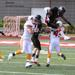 Jermaine Holmes trys to leap over Marcus Pratt