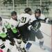 Lakeshore defenseman MacKenzie Queoff fights off three Rock County players in non-conference action