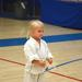 Taekwondo for toddlers as a little girl gets ready to perform at a martial arts tournament