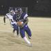 football player running the ball down field