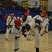 Two taekwondo black belts doing point style sparring with karate kicks