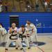 Taekwondo black belt girl practicing self-defense techniques