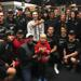 Aaron Bereton visits Eagles locker room along with play-by-play announcer Paul Conover
