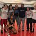 Pete DiPol with MacMurray College women's wrestling team