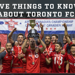 Toronto FC holding up trophy.