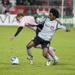 Julian de Guzman battling for possession against an opponent during a TFC game