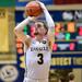 Christian Ray shoots a basketball