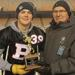 MVP - Quade Kozak of the Bellerose Bulldogs is this year's recipient of the Haliburton Trophy as the most valuable player in division one Carr conference football. Bryan Anderson presented the award to the Grade 12 Sturgeon Composite High School student o