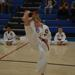 Kid's martial arts training doing a big kick in karate classes for kids