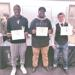 three student-athletes holding national letters of intent