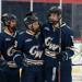 Will Yerkovich, Brian Sargent, and Cooper May celebrate after a power play goal vs. George Mason