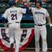 Photo Caption: Cody Regis high fives Conrad Gregor on Tuesday against the Ottawa Champions. Regis hit a solo home run and a double in the Boulder's 3-2 victory. (Photo Credits: Drew Wohl, Rockland Boulders)