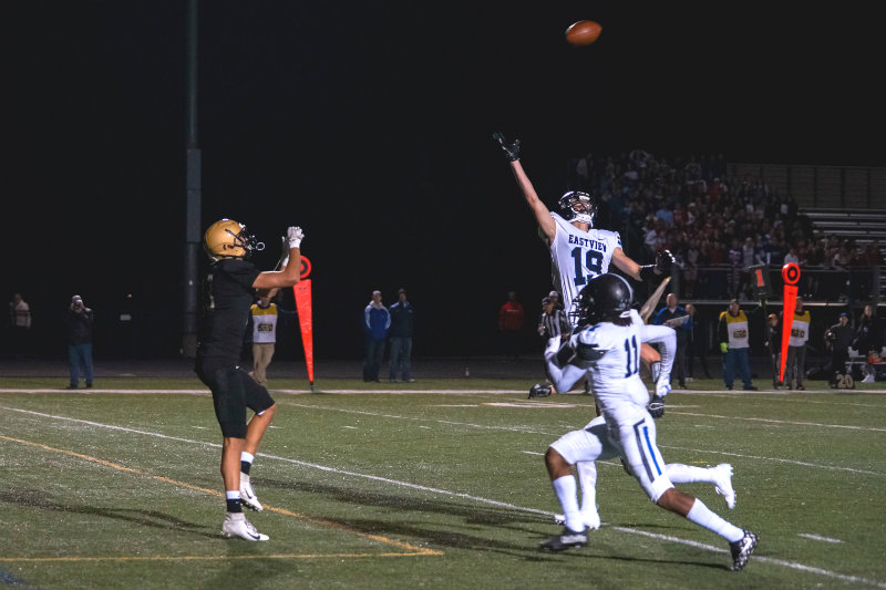 Raptors wide receiver Brody Kriesel (left) awaits a catch behind Lightning defenders in the end zone for his second touchdown of the night. Photo by Korey McDermott, SportsEngine