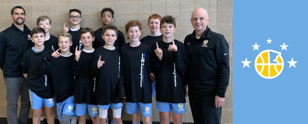 Minneapolis Lakers Boys 7th Grade Gold pose with their T-Shirts after becoming the Champions at the Rogers Winter Warmup tournament in Rogers, MN