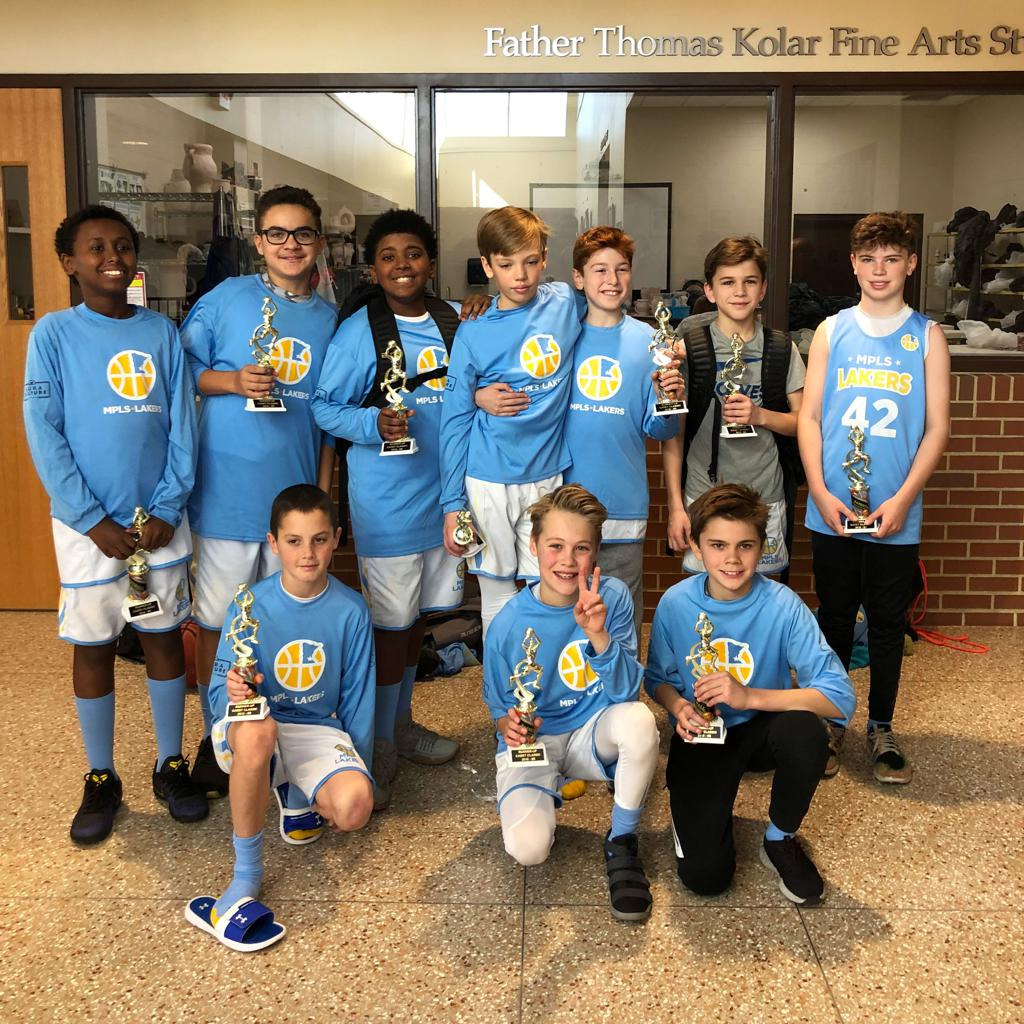 Boys 6th Grade Gold posing with their hardware