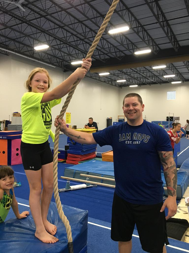 Girl swinging on rope at Jam Hops event