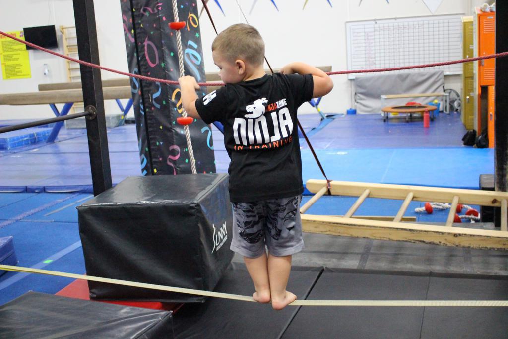 Child learning a new skill at ninja zone clinic