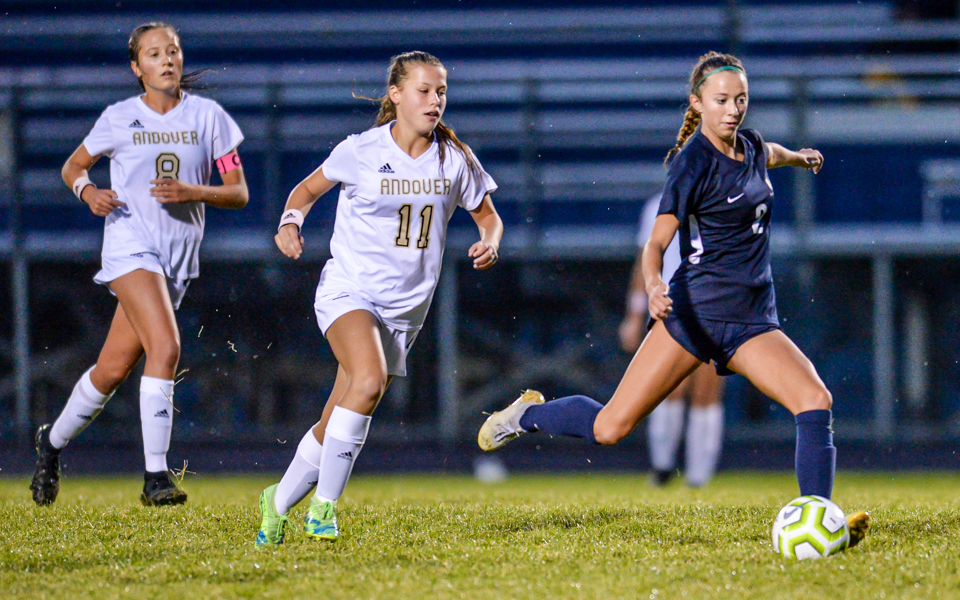 The Eagles' Kiera Laney (right) takes a shot on goal in the first half Friday night in a 1-1 tie against the Huskies. Photo by Earl J. Ebensteiner, SportsEngine