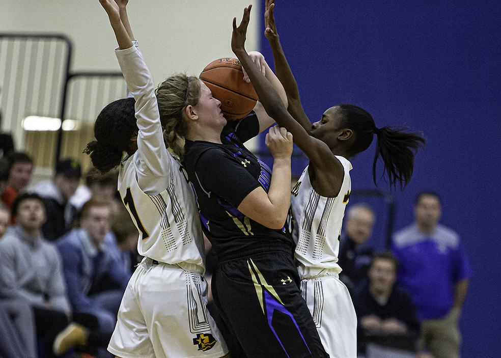 Holy Angels junior Rachel Kawiecki turned the ball over under heavy pressure from Kiani Lockett (left) and I'Tianna Salaam late in the game. Photo by Mark Hvidsten, SportsEngine