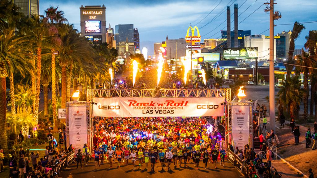 starting line of las vegas race with fire shooting out of the banner