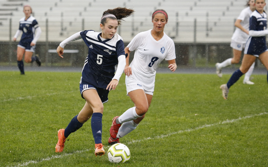 Champlin Park's Paige Kalal pushes the play upfield as Blaine's Claire Proulx gives chase. Kalal had a goal and an assist in the Rebels' 3-0 victory over the Bengals. Photo by Jeff Lawler, SportsEngine