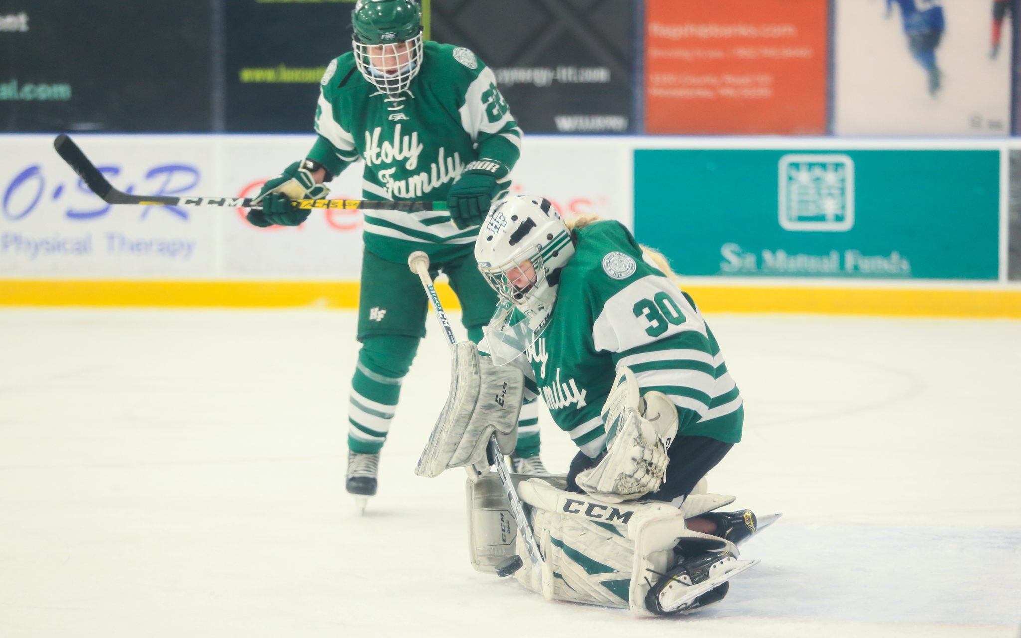 Holy Family Catholic goalie Sedona Blair (30) makes a pad save against Minnetonka in the Class 2A, Section 2 final Saturday. The Fire fell to the Skippers 4-1 in Minnetonka. Photo by Jeff Lawler, SportsEngine