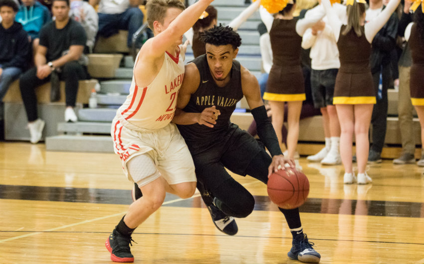 Senior guard Tre Jones works around a Lakeville North defender on Jan. 9. Jones finished the game with 22 points. Photo by Jeff Lawler, SportsEngine
