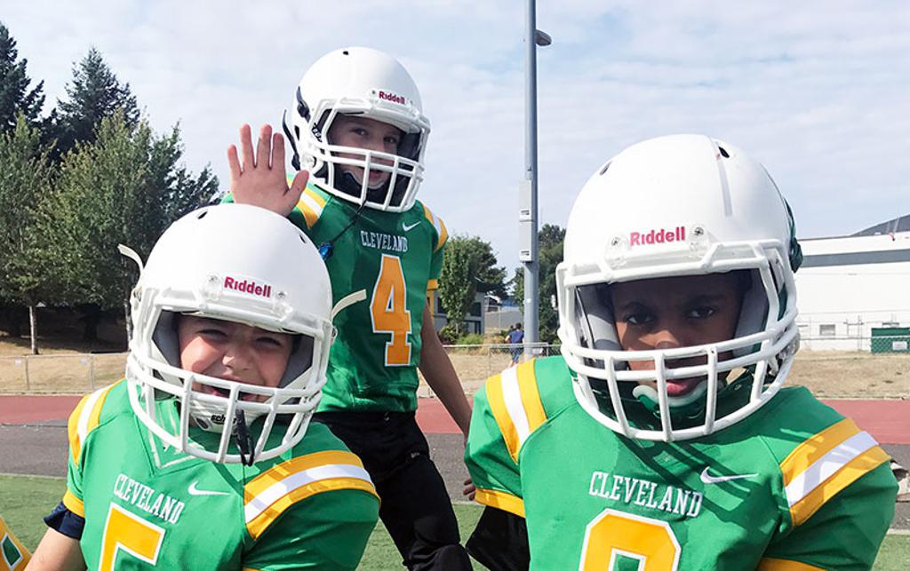 Three Cleveland Warriors Youth Football players