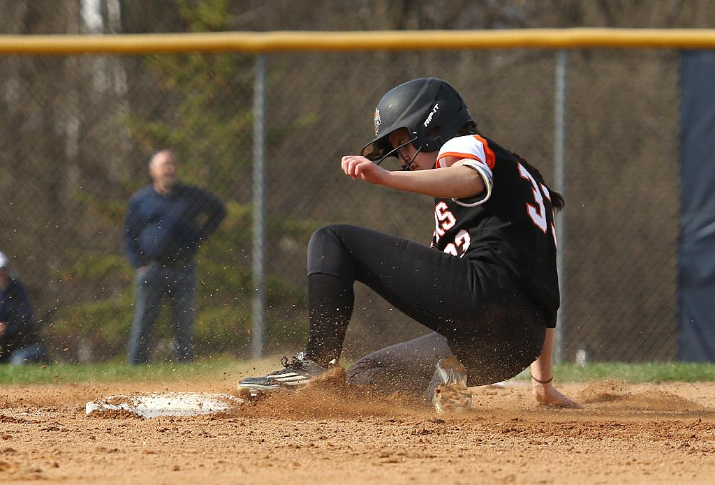 Farmington's Taylor Jasper slides into third on a one-out triple. Jasper would remain stranded through the remaining two outs in the top of the third inning. Photo by Cheryl Myers, SportsEngine