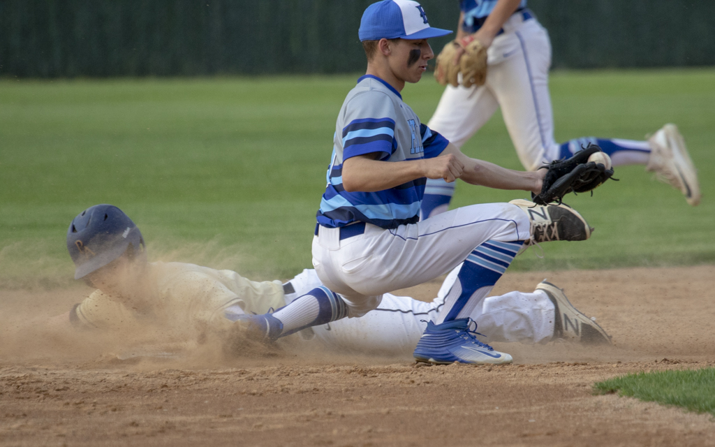 Providence Academy's Caleb Paulson safely steals second base against Heritage Christian Academy Friday night. The Lions fell to the Eagles 4-1 at Arnold Klaers Field in Loretto. Photo by Jeff Lawler, SportsEngine