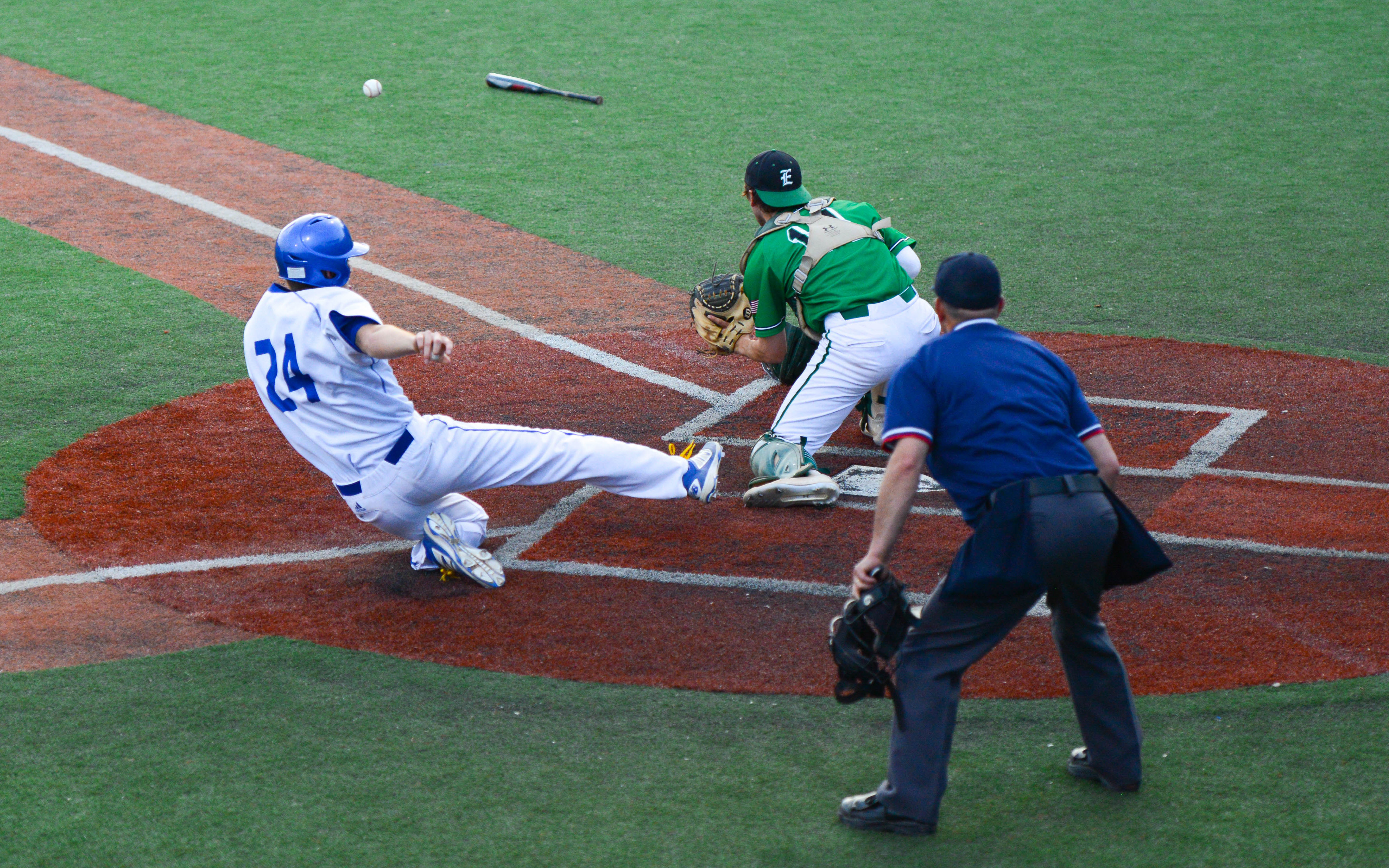 A Minnetonka base runner slides safely into home during a late-game rally. The Skippers lost to Edina 5-3. Photo by Carter Jones, SportsEngine