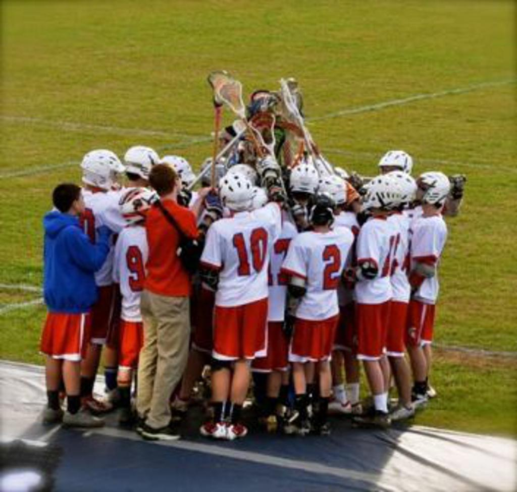 men's lacrosse team huddles before a game