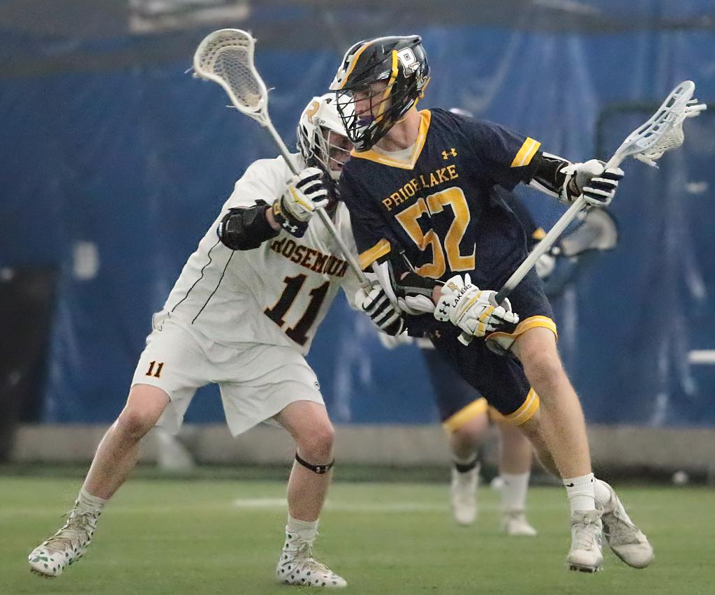 Luke Bloedow (52) works his way back through the middle around defender Cadin Rudoll (11). Bloedow, a leading point scorer for Prior Lake, was held scoreless in a 6-3 loss to Section 6 rival Rosemount. Photo by Cheryl Myers, SportsEngine