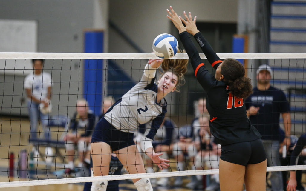 Champlin Park's Sami Hilley (2)  goes up for a kill against Osseo Tuesday night. The Rebels defeated the Orioles in three sets (25-21, 25-21, 25-9) at Champlin Park High School. Photo by Jeff Lawler, SportsEngine