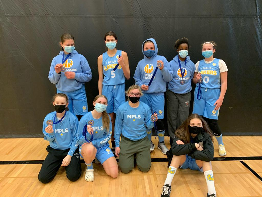 Mpls Lakers Youth Traveling Basketball Program Inc Girls 8th Grade Gold pose after placing 2nd at the Woodbury Royal Rumble tournament in Woodbury, MN