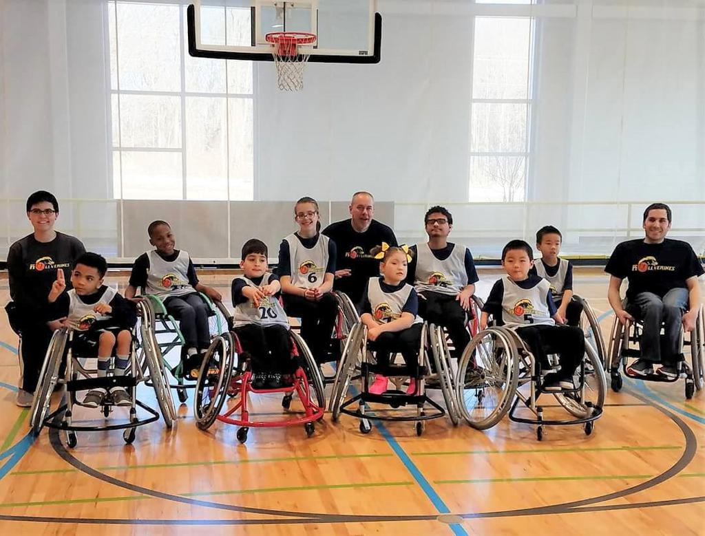 a team photo of the Rollverines players and coaches