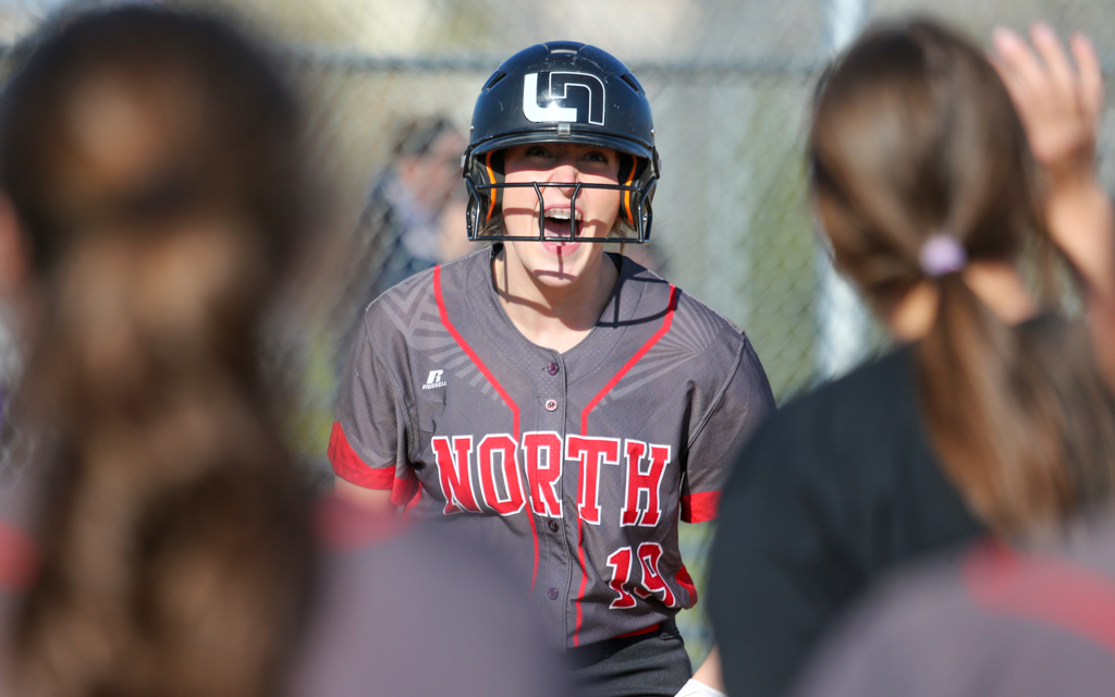 Lakeville North's Jordan Ahrenstorff (19) celebrates her game-tying home run in the bottom of the seventh inning against Rosemount Wednesday evening. The Panthers handed the Irish a 2-1 loss in eight innings. Photo by Jeff Lawler, SportsEngine
