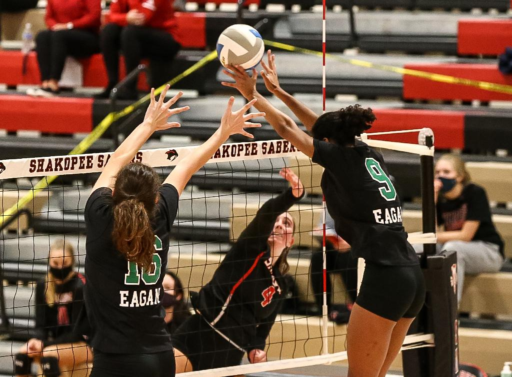 Eagan's Sienna Ifill (9) makes a block in the second set. The Wildcats staged a comeback after losing the first two sets but faltered in the fifth set to lose the match. Photo by Cheryl A. Myers, SportsEngine