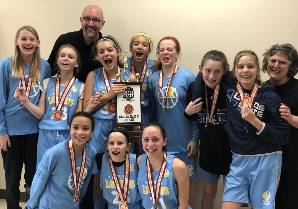 Mpls Lakers Youth Traveling Basketball Program Inc Girls 6th Grade Blue pose with their Trophy after placing 3rd at MYAS Grade State year end tournament in Osseo, MN