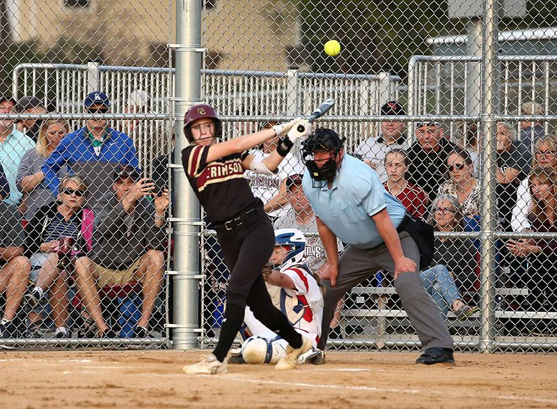 Ava Dueck of Maple Grove (pictured hitting a home run) was already a very good pitcher in 2018, but it wasn't until her senior year when she started hitting for power, as she blasted a state-best 16 homers. Photo by Cheryl A. Myers, SportsEngine