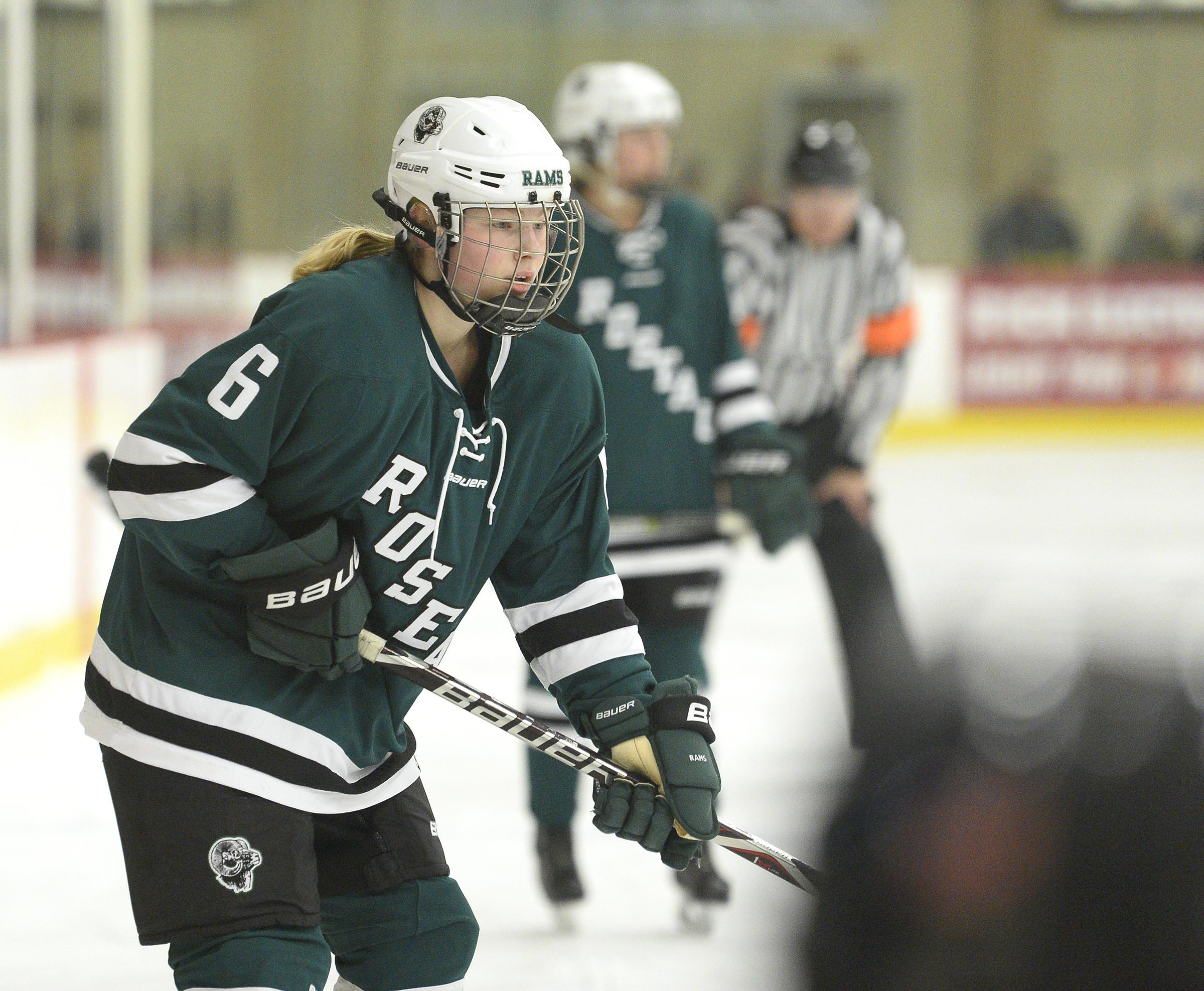Roseau's Kayla Santl (6) recorded her 100th career point with a second-period assist on Reese Strand's goal. The Rams beat the Spuds 6-0 on Tuesday night. Photo by Tim Kolehmainen, SportsEngine