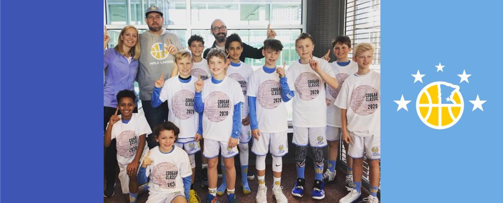 Mpls Lakers Youth Traveling Basketball Program Inc Boys 5th Grade Gold pose with their T-Shirts after becoming the Champions at the Lakeville South Cougar Classic tournament in Lakeville, MN