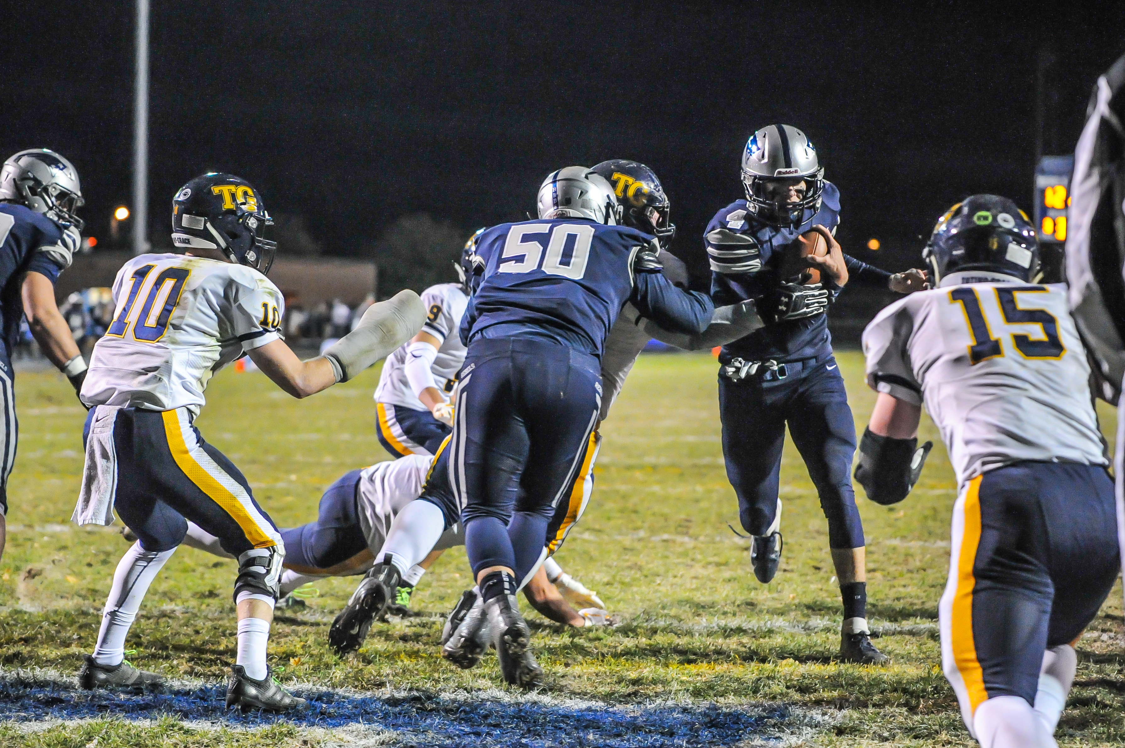 Champlin Park's Jaice Miller rushes into the end zone in the final game of the regular season, beating Totino-Grace 41-34 Wednesday evening. Photo by Earl J. Ebensteiner, SportsEngine